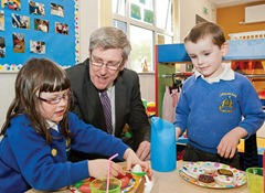 Education Minister John O'Dowd, today officially re-opened Arvalee School and Resource Centre in Omagh, which was largely destroyed by fire las year. Photographed with the minister on a tour of the school are Kiera Mullin and Charlie Leonard.