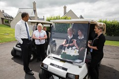 President Barack Obama talks with housekeeping staff outside of a lodge at the Lough Erne Resort during the G8 Summit in Enniskillen, Northern Ireland, June 17, 2013. (Official White House Photo by Pete Souza) 