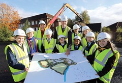 ©/Lorcan Doherty Photography -  23rdOctober 2013.   Education Minister visits Omagh for the start of demolition at the site of the new Lisanelly Shared Education Campus.   Education Minister John O'Dowd and Hazel Jones, Lisanelly Programme Director, with pupils from the 6 local schools that will relocate to the new Lisanelly Shared Education Campus.  Photo Lorcan Doherty Photography