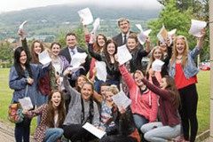 Education Minister John O'Dowd and Employment and Learning Minister Dr Stephen Farry who congratulated St Genevieve's High School pupils Stephen Hare, Jacinta Hamley and David Beattie on their GCSE results.  Picture by Brian  Morrison.