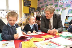 6/2/14: Education Minister John O'Dowd with pupils at Anahorish Primary School, Toomebridge. The Minister enjoyed a tour of Anahorish PS as he visited two schools in the Magherafelt District Council area. Minister O'Dowd subsequently went on to visit Kilronan School, a special school in Magherafelt.. Picture: Michael Cooper