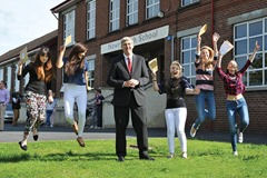 PRESS RELEASE IMAGE  14/8/14: Education Minister John O'Dowd with Newry High School pupils, (left-right) Nicole Hempkin, Nadine Hempkin, Victoria Fleming, Naomi Body and Sarah Cathers who received their A results today. Picture: Michael Cooper