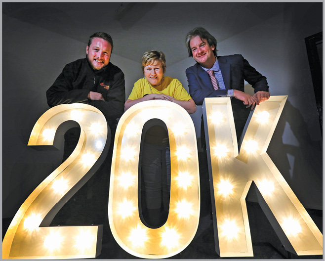 Michael Scott, Managing Director of firmus energy (far right), and colleague Joe Diver (far left), are pictured with Cathy McKillop from SHINE, celebrating the news that firmus energy team members have raised £20,000 for the charity.
