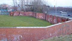 Remaining barriers: peace wall alongside the Westlink, in Belfast
